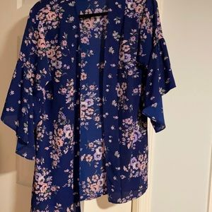 Blue open wrap with three quarter ruffle sleeves